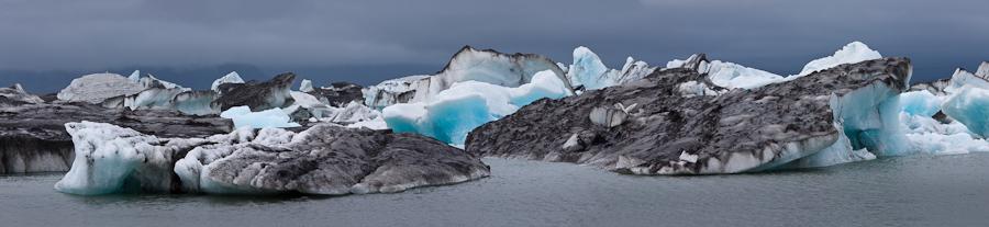 Icebergs and volcanic ash; Jokulsarlon, Iceland.
